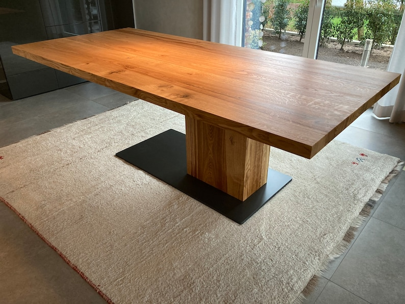 Dining table made of an oak plank on 1 1/2 legs unique image 1