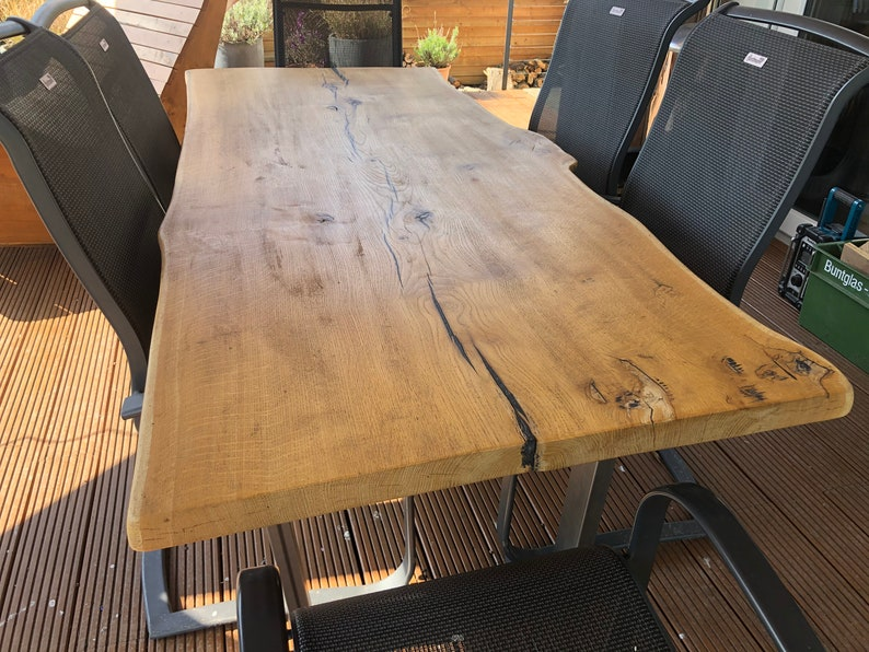 Terrace dining table made of an oak plank quality from the image 0