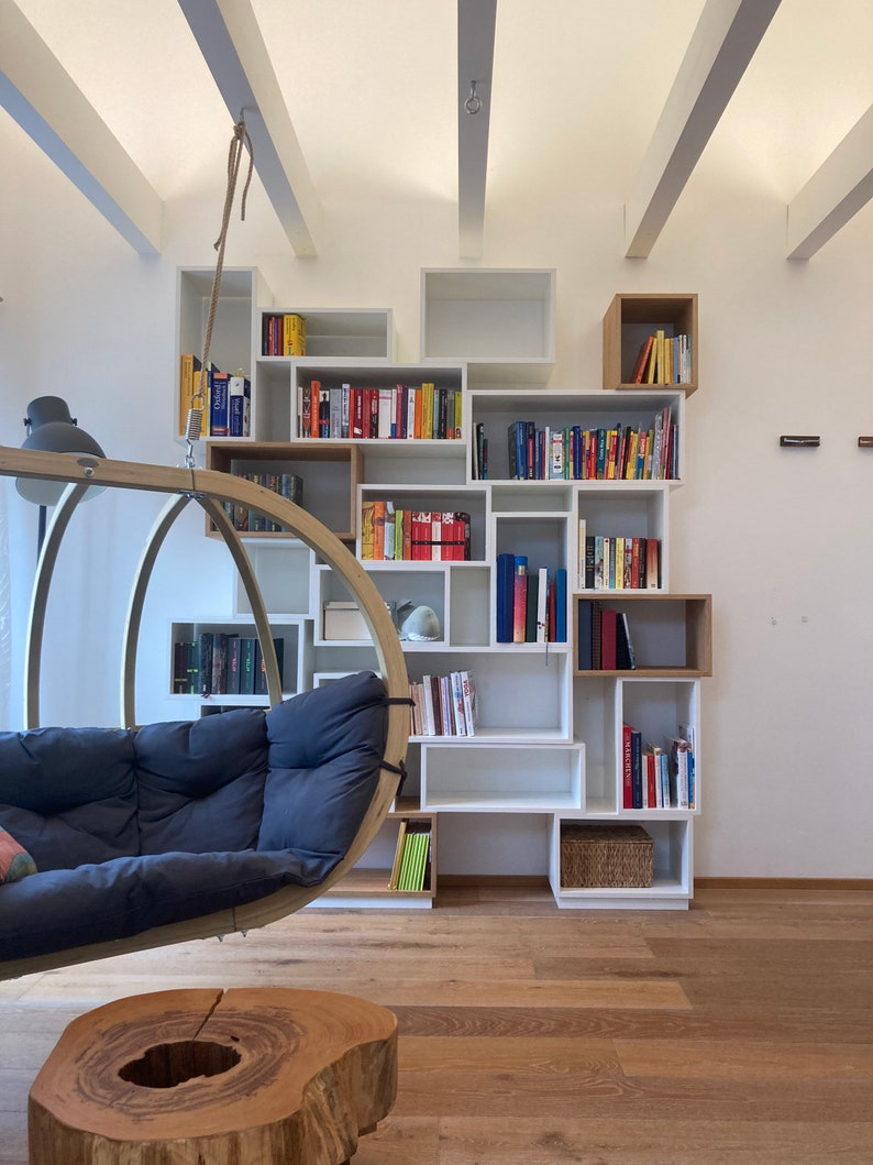 Flexible shelf system in white and oak bookcase image 1