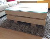 Coffee table made of spruce solid wood beams cracked