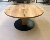 Round dining table made of oak on one foot