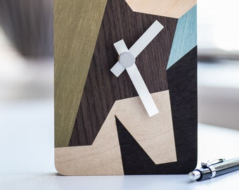 One-off contemporary abstract design hand-cut marquetry art clock.