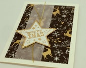 "Christmas greeting card ""merry xmas"" in fine black gold with trendy deer motif"