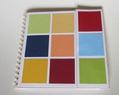 "Notebook ""carousy"" with colored riders in spiral binding, upcycling items from a table calendar"