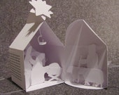 Christmas nativity scene in the paper house, a gift idea all in white