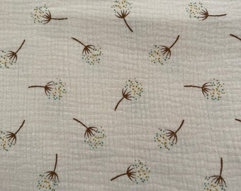 Muslin with dandelions in a soft pink
