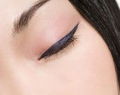 Liquid, Precision Eyeliner. Long lasting and comes in 5 colors. Great for wedding makeup