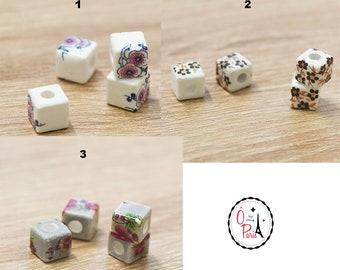"""10 cubic porcelain beads """"flower"""" 11x11 mm, lilac / black orange / plum"""