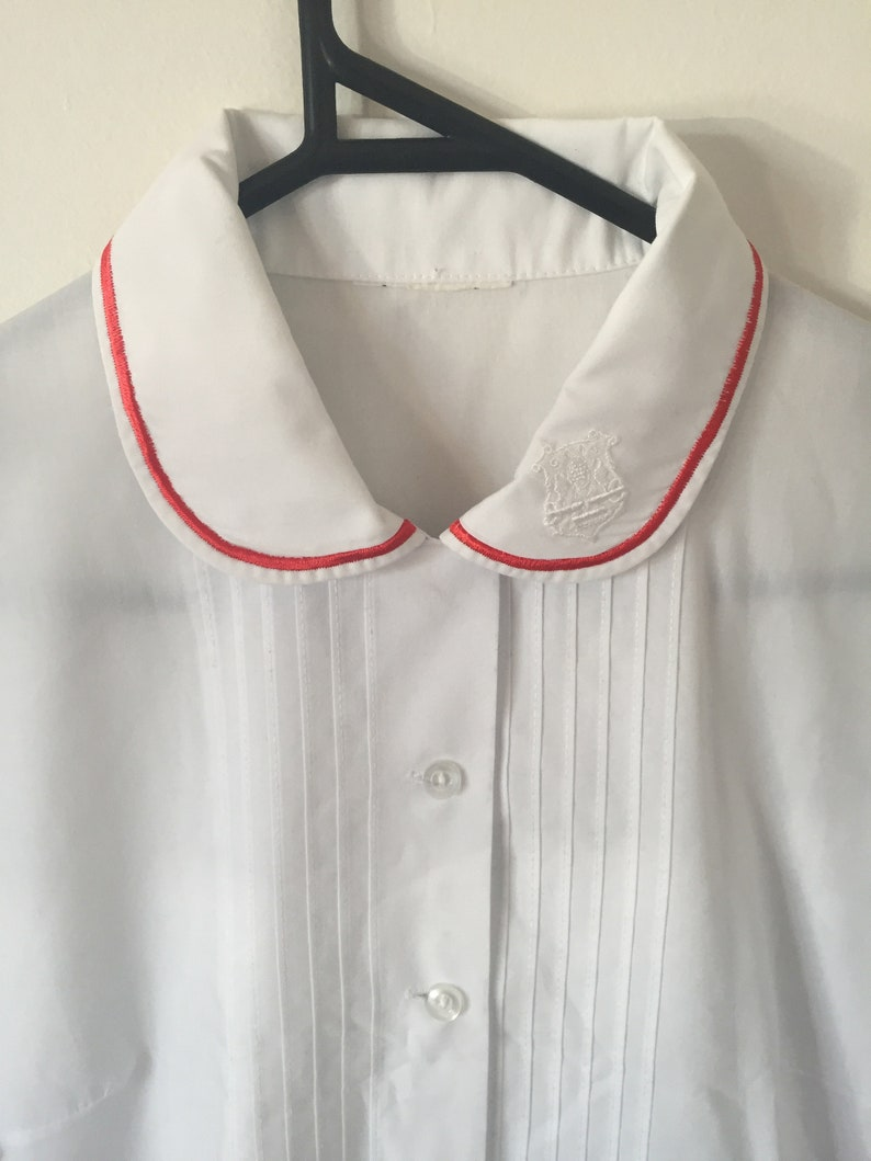 INCREDIBLE 80s White Peter Pan Collar Blouse with Embroidered Royal Crest and Red Piping