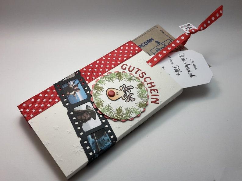 Christmas cinema voucher with microwave popcorn  motif Weihnachten Rentier