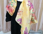 Colourful lillies on a yellow Hand painted silk scarf.