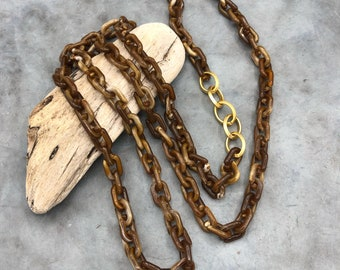 Long chain link chain brown link elements gold