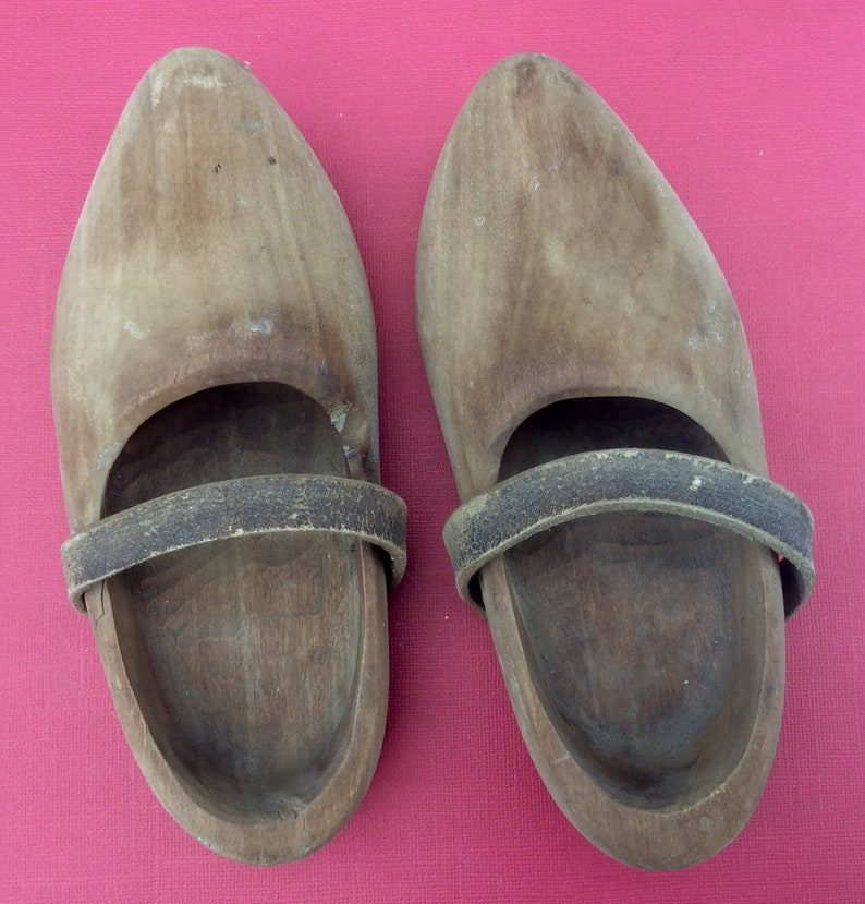 c101345bd1af2 One pair of Antique wooden clogs & leather stripes, hand carved children's  wooden shoes. Dutch. The Netherlands