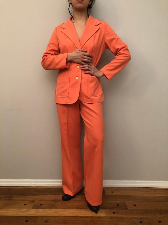 Two piece set suit in orange color