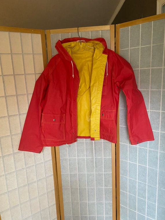 Vintage 1970's red and yellow reversible rain coat