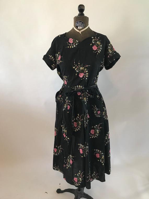 Vintage 1940s black wrap dress with floral motif,