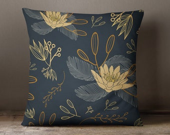 Gold throw pillow with flowers decoration