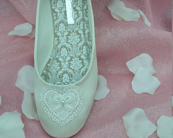 8b3ac12f9a2 Flat ivory satin wedding shoe with lace love heart.