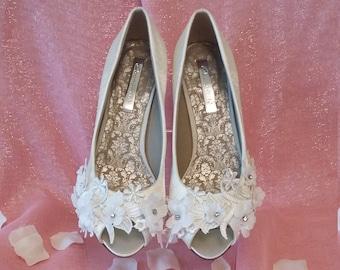 eb5f29bb1f3 Ivory satin peep toe shoe with Guipure lace trim.