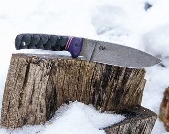 Arcadian camp knife in O-1 with acid stonewash, black canvas micarta with purple and pink forward bolsters
