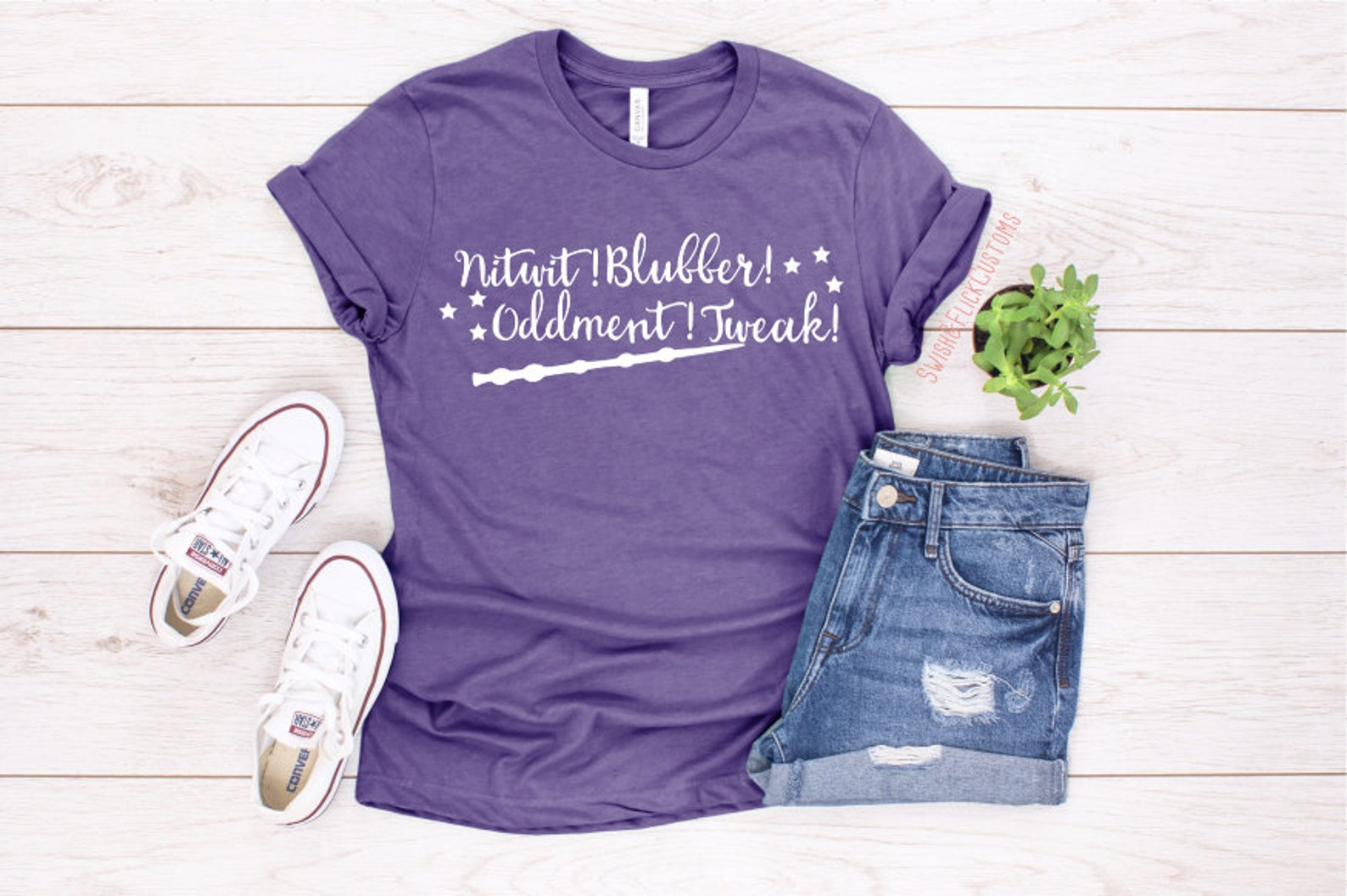 Purple flat lay Harry Potter T-shirt with Dumbledore sayings and wand