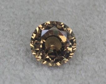 0.78 carats   Natural Orange Sapphire   5.38 x 5.23 mm   Round Shape   Loose Gemstone