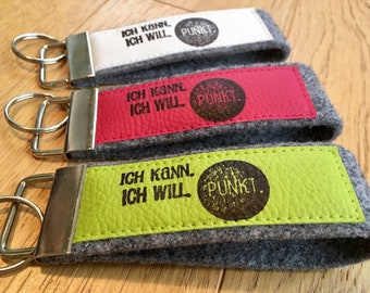 """Felt keychain with faux leather, lanyard, printed, stamp, text """"Just something next to the track. It's nice there!"""""""