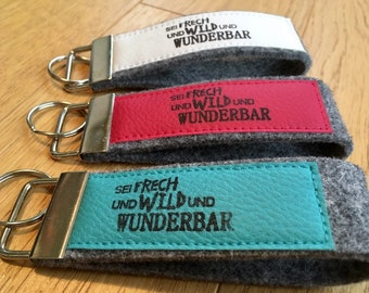 """Felt keychain with faux leather, lanyard, printed stamp, text """"Be naughty and wild and wonderful"""""""