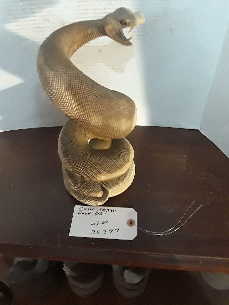 Snake coiled from Bali hard wood some teeth missing
