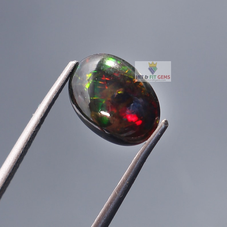 1.45Carat Black Opal Oval Cabochon 10x8mm Natural Ethiopian Welo Fire Opal Video Available