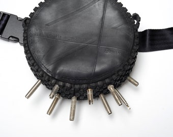 Belly bag made of tractor hose, bicycle wheel tires and valves