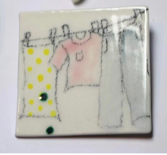 Vintage Artisan Porcelain Pin, wash day, Hand painted clothing on a clothes line