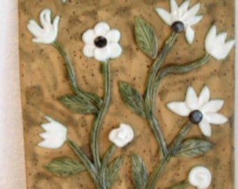 Brown wall tile with white flowers - ceramic