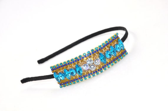 gold details,pearls and butterfly in the middle. Handmade embroidered headband luxe with genuine crystals of different shades of blue
