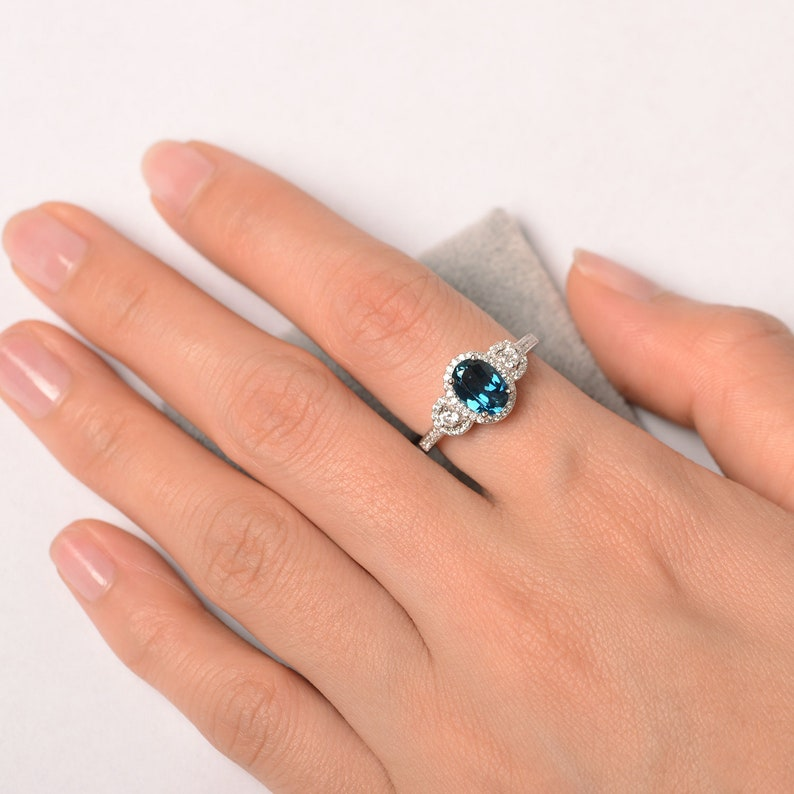 London blue topaz ring oval cut halo engagement ring