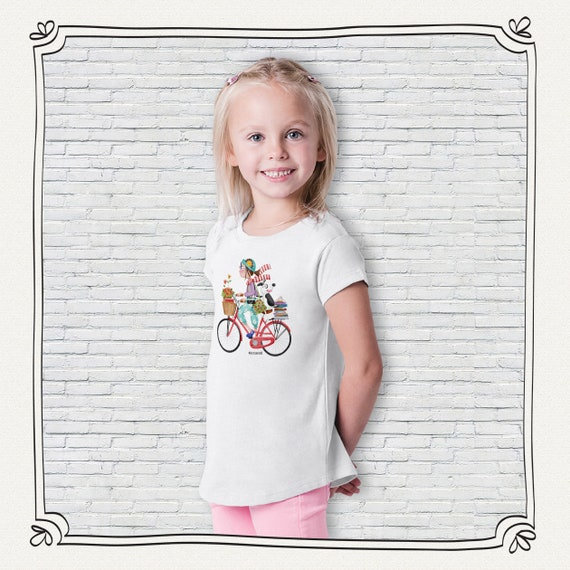T-shirt girl bike design by Mónica Carretero Momo Shop