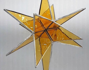 12-pointed star in honey yellow glass, Christmas, light play, wind chime, spring, summer