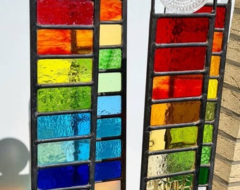 Garden panels made of stained glass in lead glazing with vintage element (old glass coaster) beautiful light reflections