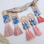 Polymer clay tassel earrings with blue and copper marbling and blush or coral tassels