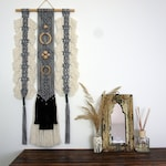Black and white monochrome statement wall art. Macrame wall hanging with bohemian and tribal vibes