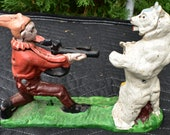 cast iron hand painted bear and hunter bank Banker