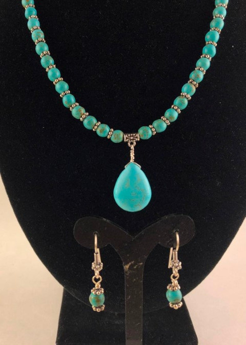 Blue Turquoise Pendant Wire Wrapped to a Necklace of Turquoise Beads Separated by Silver Daisy Spacers with Matching Earrings