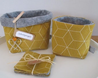 Two Utensilos Medium and small with three matching coasters in trendy okker yellow with honeycomb pattern, inside felt fabric, plus guardian angel
