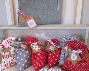 """Sustainable advent calendar for filling, """"X-MAS"""", made of 6 different bags, packed in a felt bag, with ribbons and kraft paper stars"""