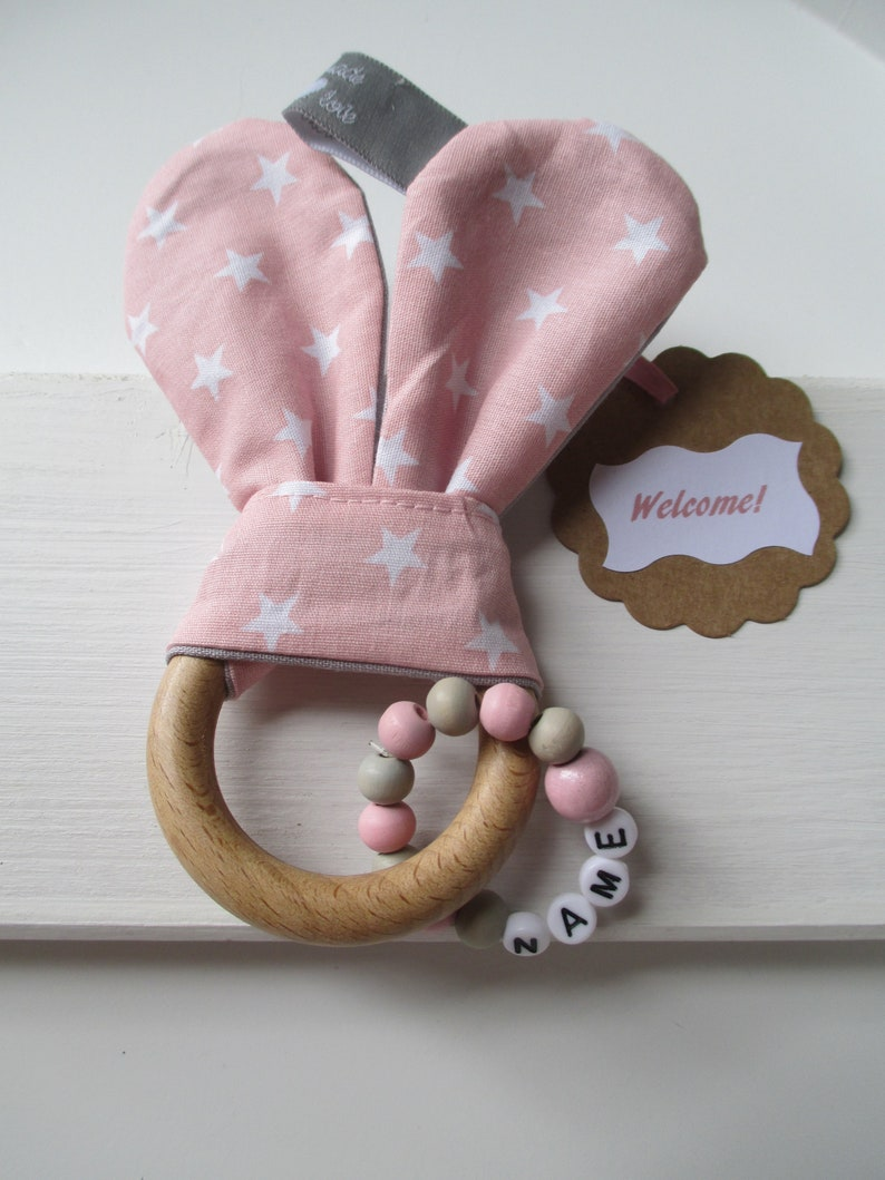 Crackling bunny/gripper with natural wood ring and name chain Pink