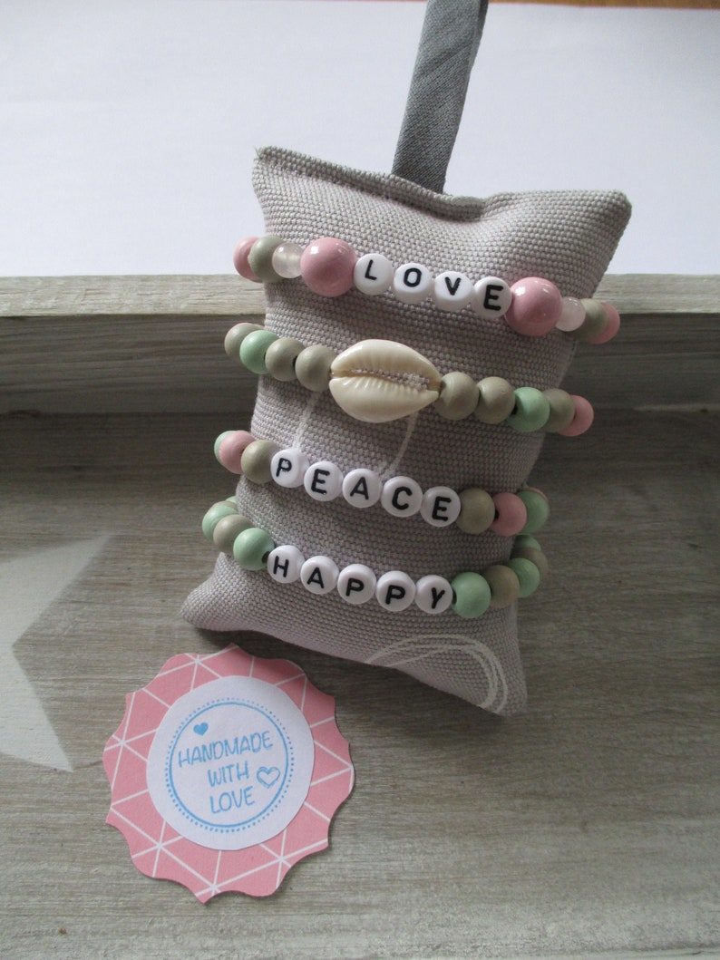Choose your bracelet from wooden beads with massage or shell image 0