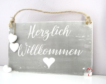 Wooden sign warm welcome with heart gray