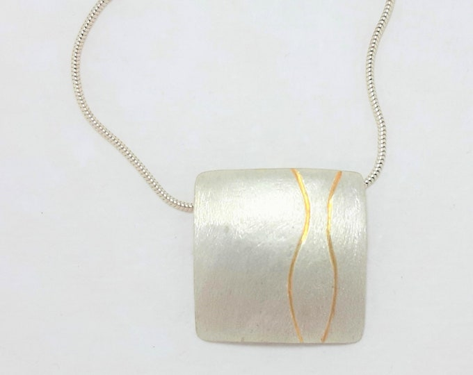 Pendant silver with gold