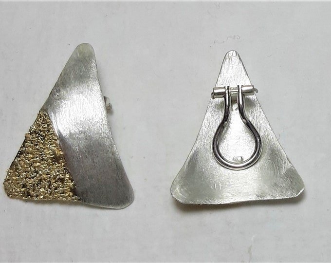Silver ear clip with gold