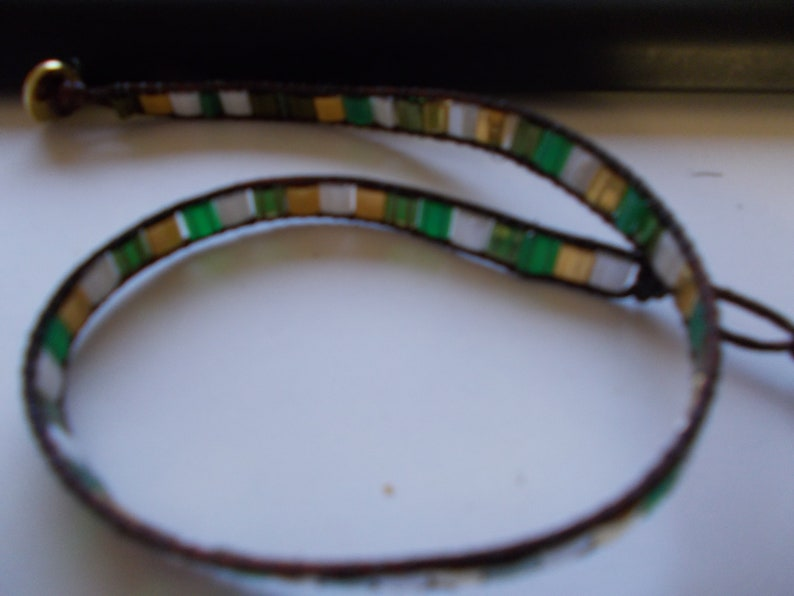 bracelets weaved bracelets with tila glass pearls  button in gold color ca 32 cm long gold white green colors